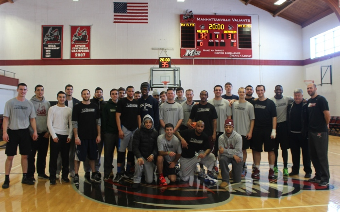 Men's basketball team along with visiting alumni and Professor Bowling